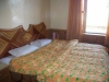 Room at hotel River West Manali